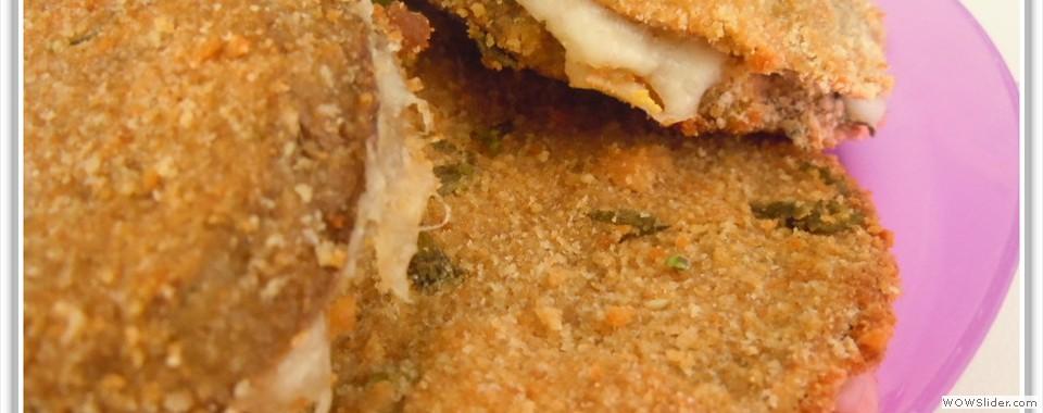 Melanzane ripiene di mozzarella e prosciutto